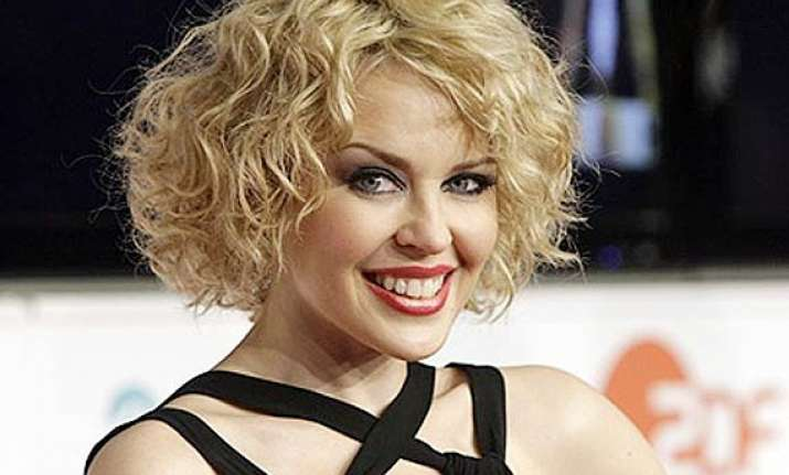 kylie minogue s dates are approved by her staff