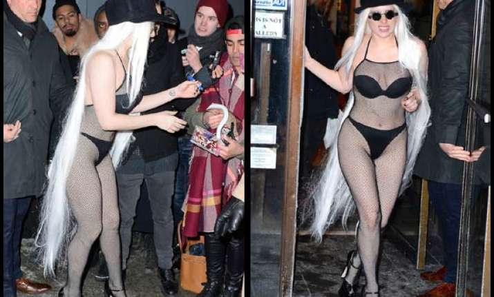 lady gaga dares to bare in fishnet stocking see pics
