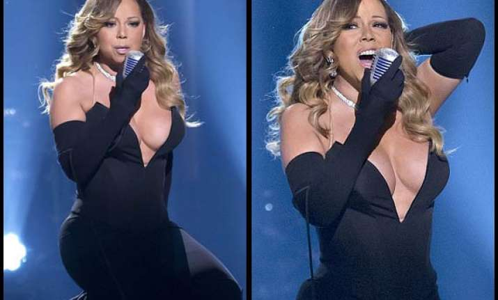 curvy mariah carey reveals ample cleavage in a black dress