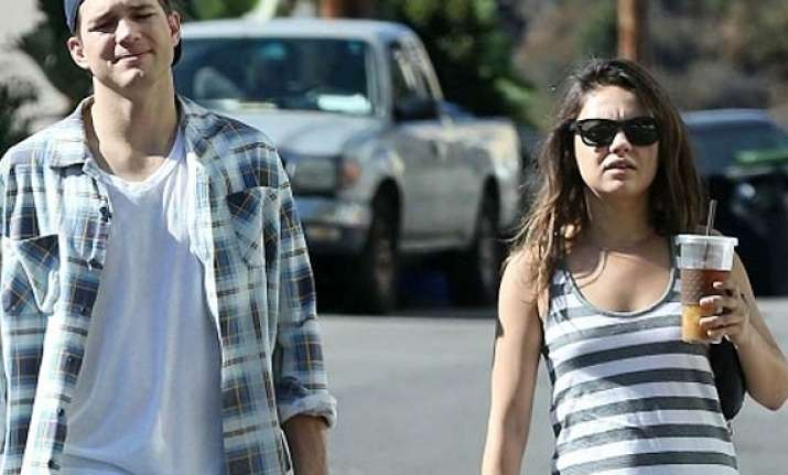 mila kunis shows baby bump