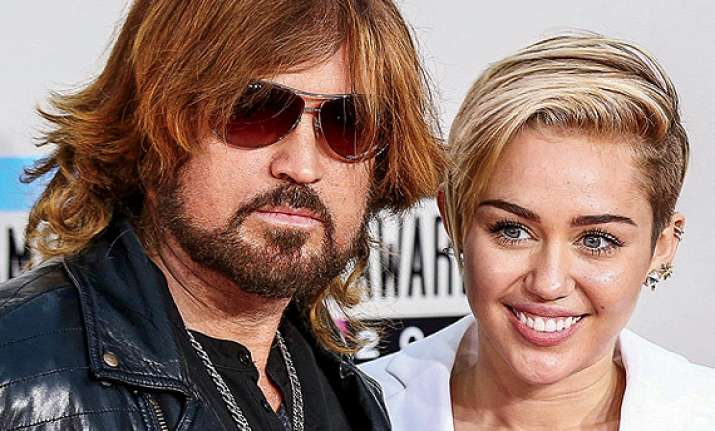 miley cyrus s dad plays matchmaker