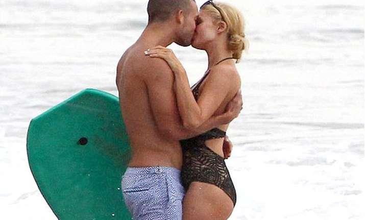 paris hilton kisses a man at beach not her boyfriend