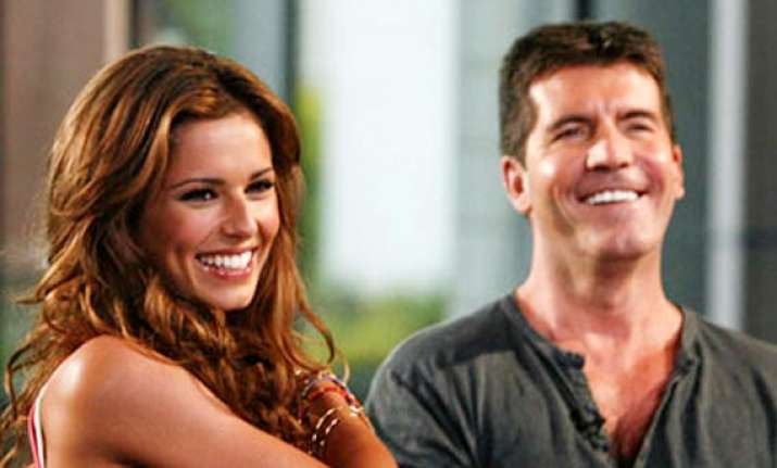cheryl happiest than ever believes simon cowell