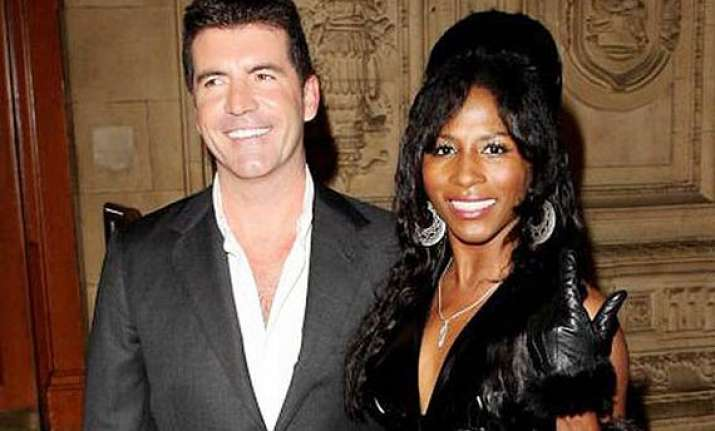 simon cowell asks ex girlfriend sinitta to be son s