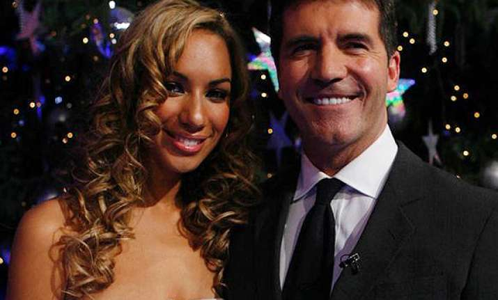 cowell was supportive of record label move says lewis