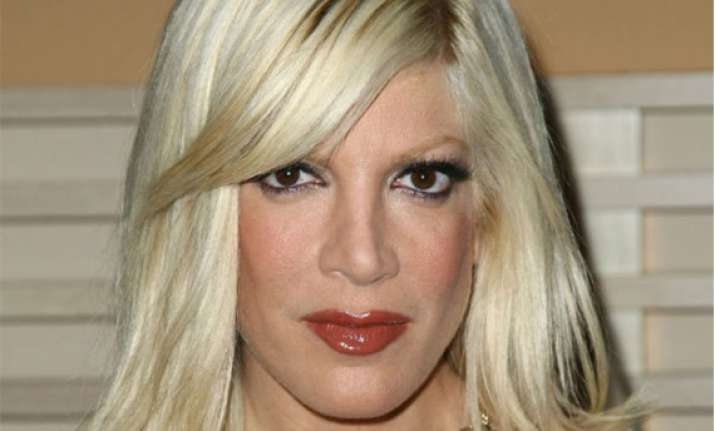 tori spelling wants to rebrand herself sans husband
