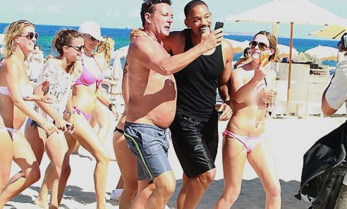 actor will smith mobbed by topless fans in ibiza