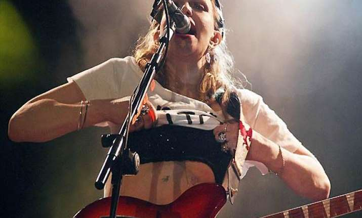 courtney love strips off t shirt during brazil concert