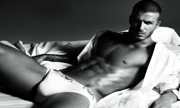 david beckham flaunts toned abs in new ad see pics