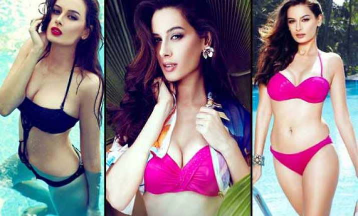 evelyn sharma hot poses in two piece for a magazine view