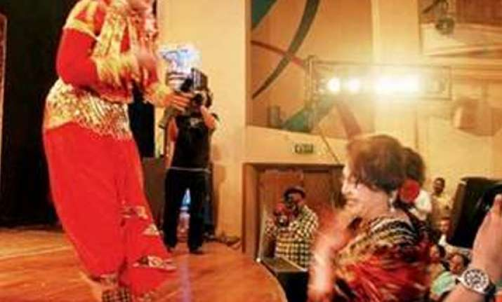 helen touches sudha chandran s feet after watching her dance