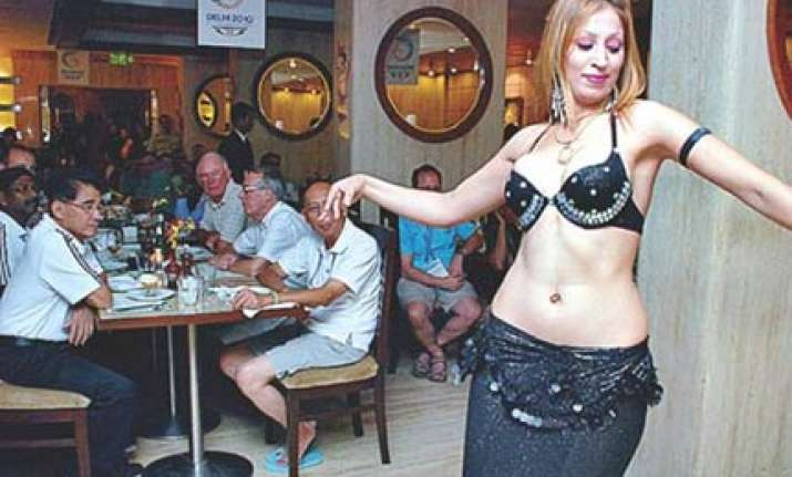 games officials chill out in the evenings with belly dancers