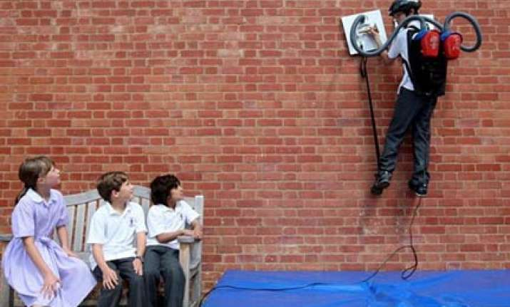spider boy in uk scales walls with vacuum cleaners