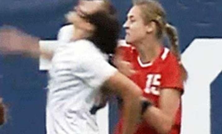 hair pulling woman footballer suspended