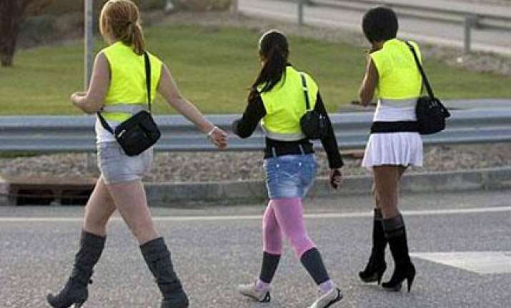 sex workers in spain asked to wear reflective vests for