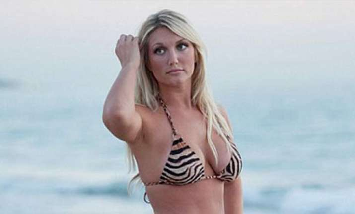 brooke hogan poses in tiger print bikini