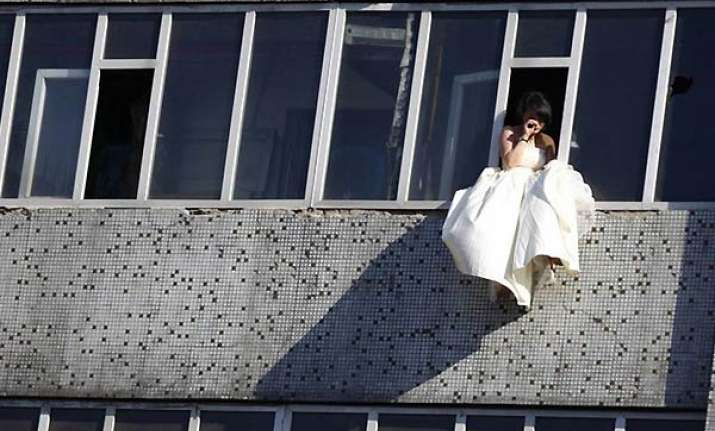 jilted bride in china tries to leap from seventh floor in