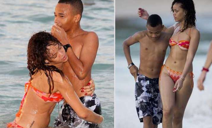 rihanna splashes on barbados beach with her brother rajad