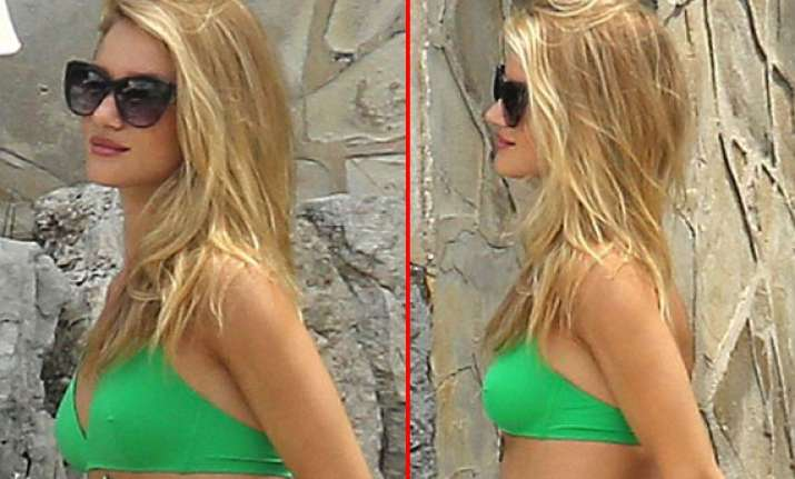 rosie huntington shows off her curves in a two piece view