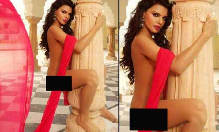 sherlyn chopra poses nude with a pillar view pics