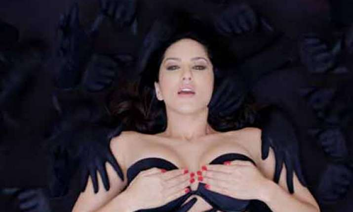 sunny leone hides her formidable twins with her hands in