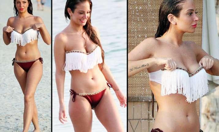 tulisa contostavlos seduces in a skimpy bikini view pics