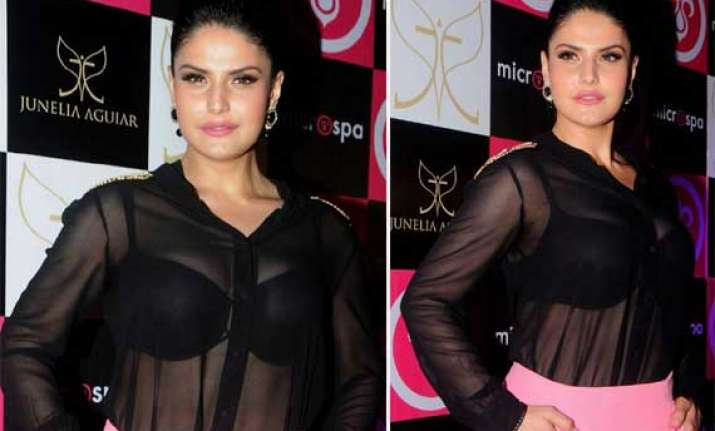 zarine khan flaunts black bra in see through dress at