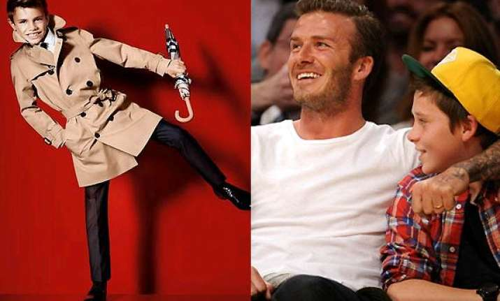 david beckham helps sons brooklyn romeo on their first