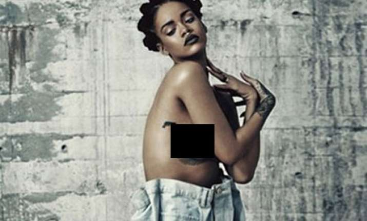 rihanna poses topless for magazine shoot
