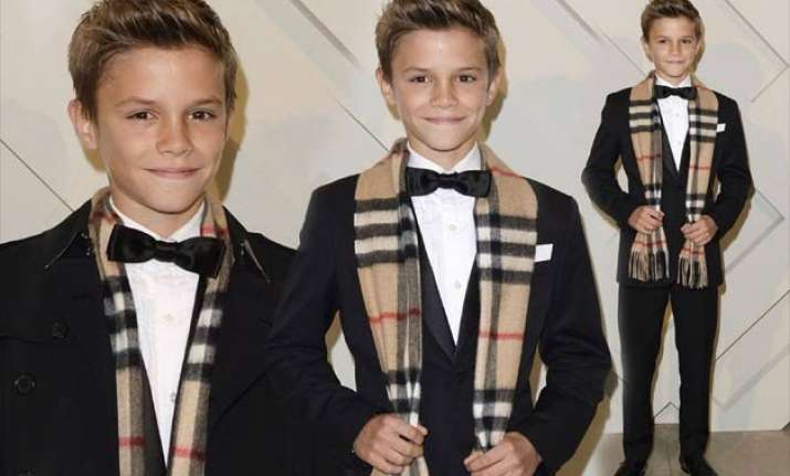 romeo beckham boosts burberry sales