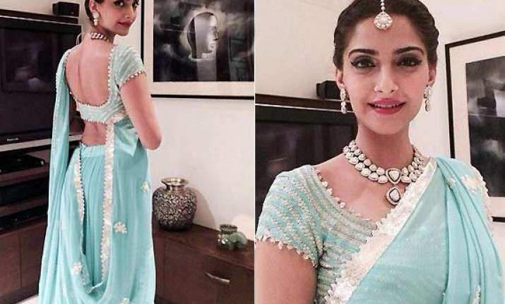 sonam kapoor looks lovely in an arresting blue lehenga at