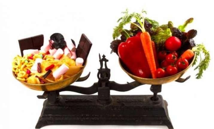 vegetables vs junk food children eating carrots and apples