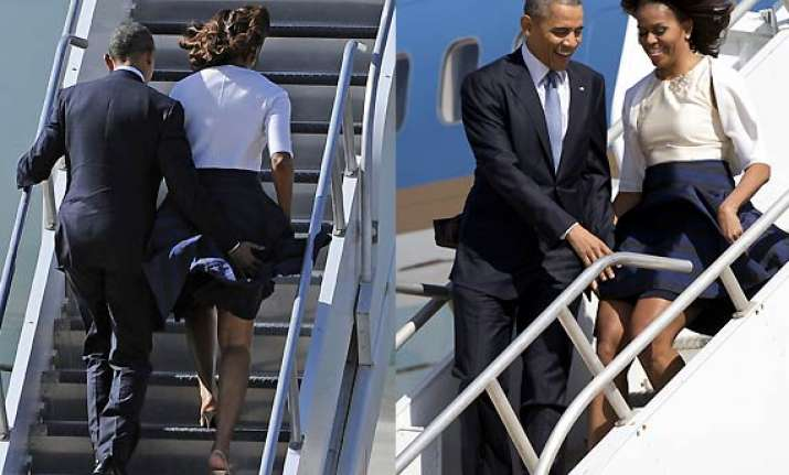 president obama averts wife michelle s skirt from blowing