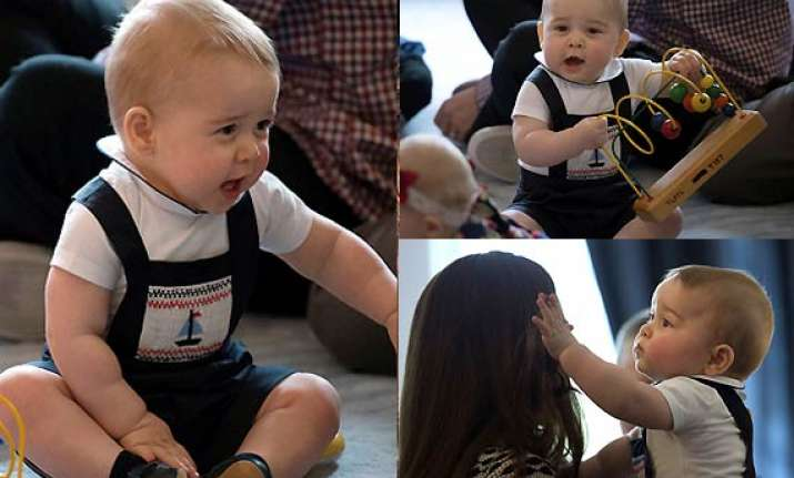 prince george turns playful on his first official public