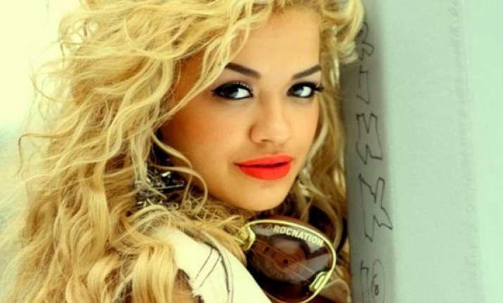 red lipstick helps make an impact rita ora