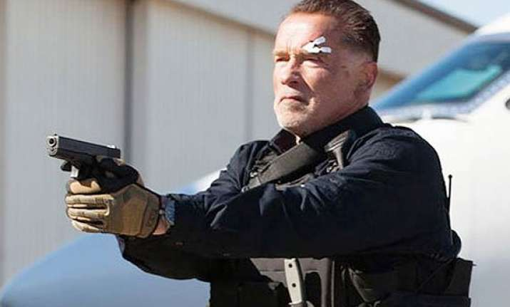arnold schwarzenegger hates his new haircut wears hat to