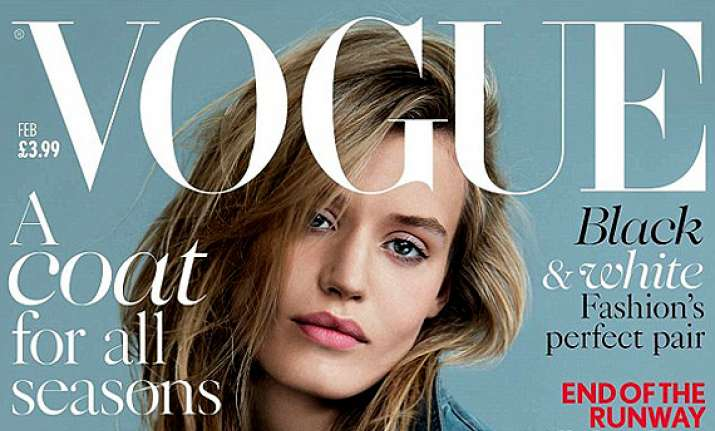 georgia may jaggers poses in just a denim jacket for vogue