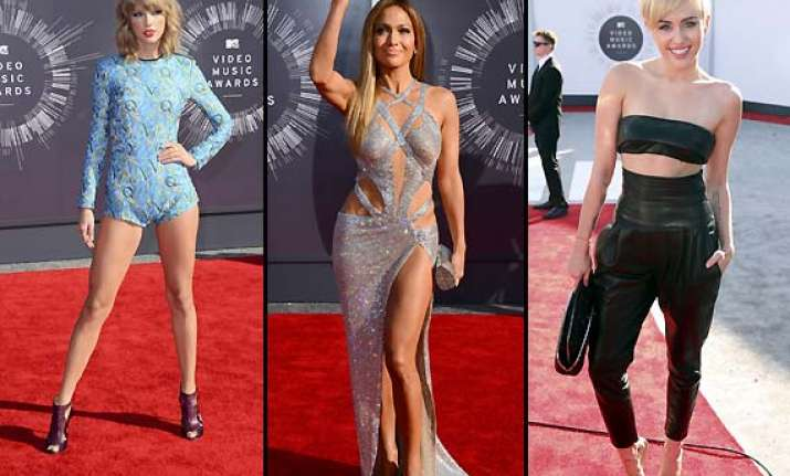 miley cyrus jennifer lopez taylor swift look voguish at mtv