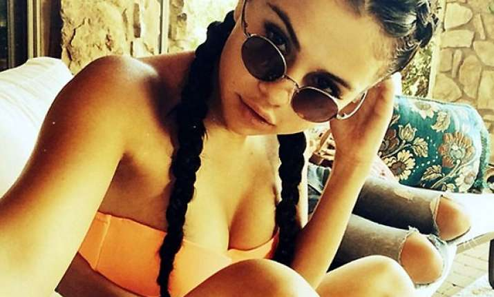 brave selena gomez posts selfie in skimpy orange bikini see
