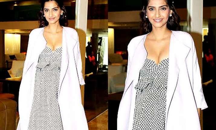 sonam kapoor flaunts her cleavage looks dewy hot see pics