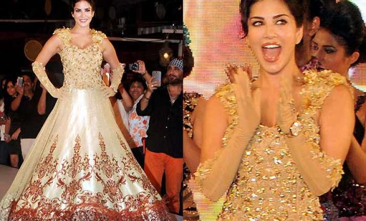 sunny leone turns golden beauty for designer rohit verma