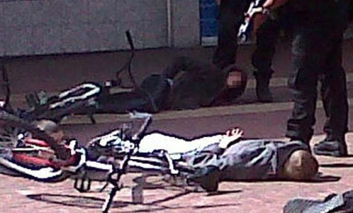 armed police officer holds gun to boy s head in manchester