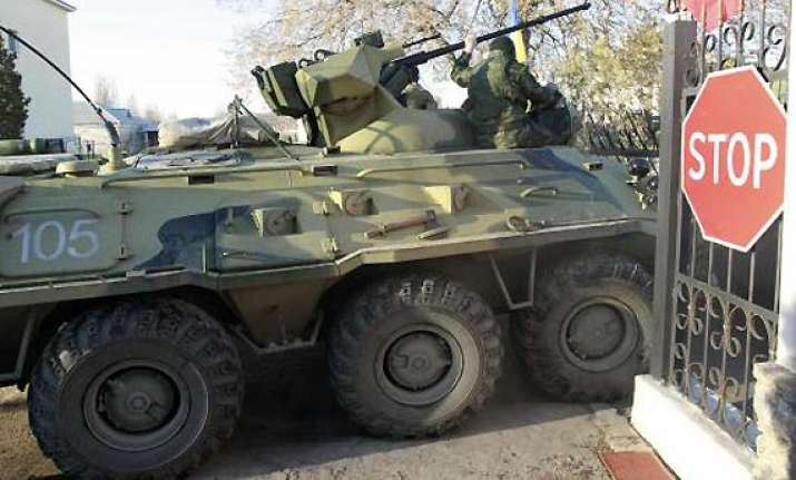 armoured vehicles enter ukrainian town