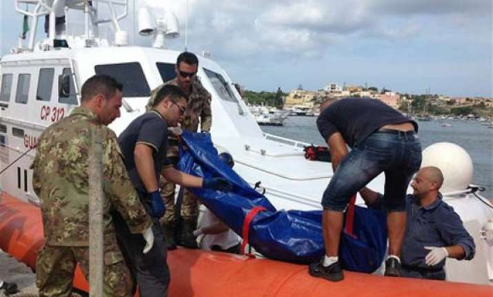 at least 94 dead in migrant shipwreck off italy