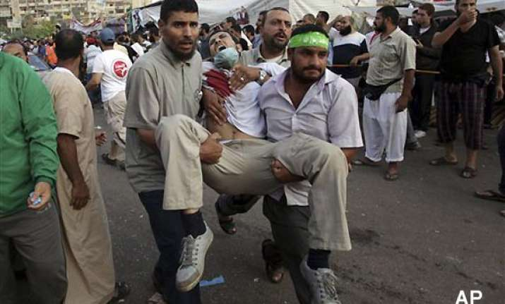 at least 75 killed in police firing on pro morsi supporters