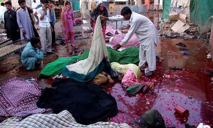 taliban twin bombers kill 42 at shrine 100 injured