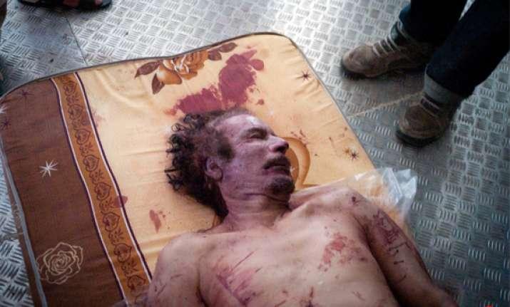 autopsy done on muammar gaddafi s body