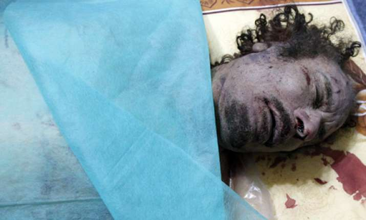 autopsy report says gaddafi killed by shot to head