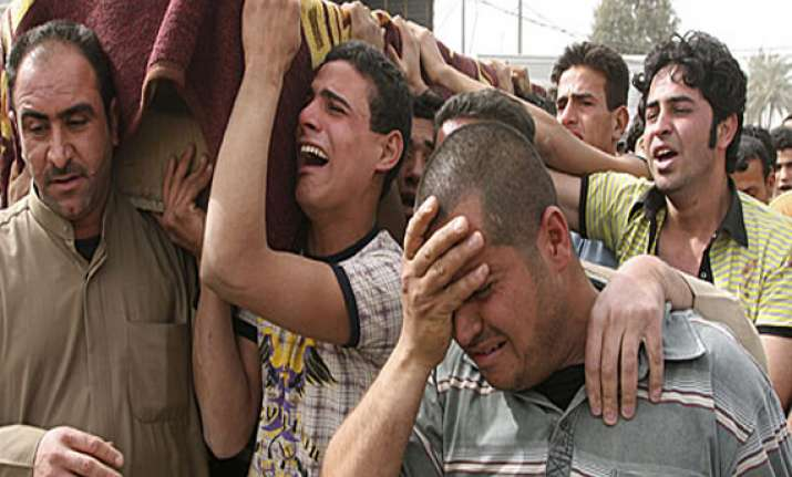 baghdad market bombs kill 14 wound more than 100
