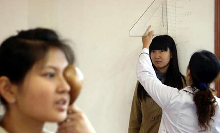 beijing begins military recruitment of college students